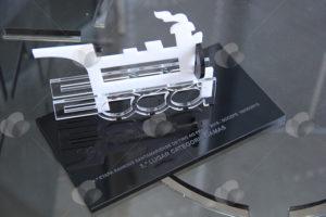 Troféu em Acrílico feito com recorte a laser e colagem. Personalizado com gravação a laser na base. Referência ao monumento da Maria Fumaça.